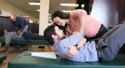 Chiropractic student performing an adjustment in the Chiropractic Clinic at Life Chiropractic College West
